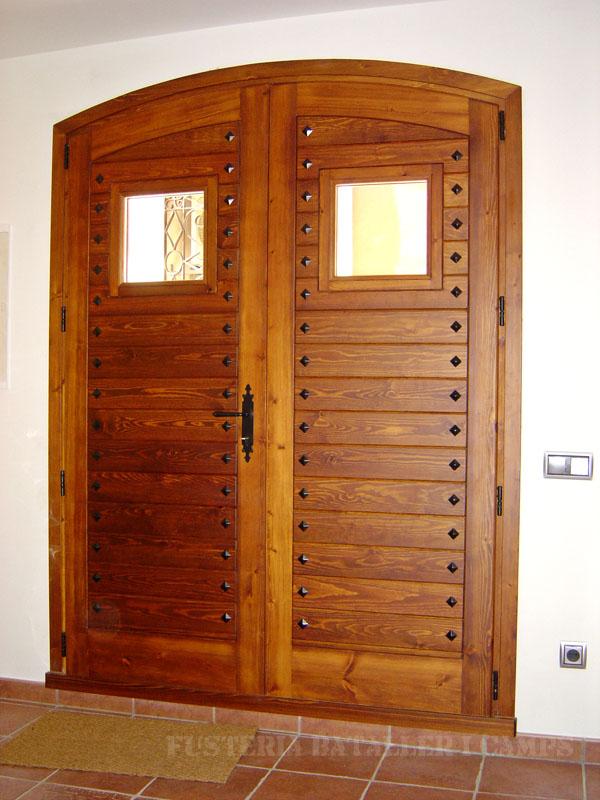 Porta exterior doble fulla encadellada pi vista interior