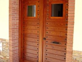 Porta exterior doble fulla encadellada pi vista exterior